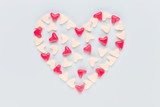 Valentines day background pastel hearts on blue wooden background.