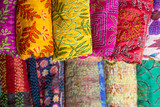 Display of colorful traditional batik scarves in the art souvenir shop