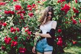 Woman at a rose bush