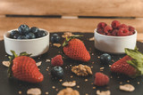 Red fruits with cereals and nuts