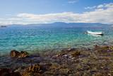 Paradise Turquoise Adriatic Sea with white boat. Krk Island, Croatia.
