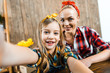 Leinwandbild Motiv selective focus of cheerful kid taking selfie with beautiful mother