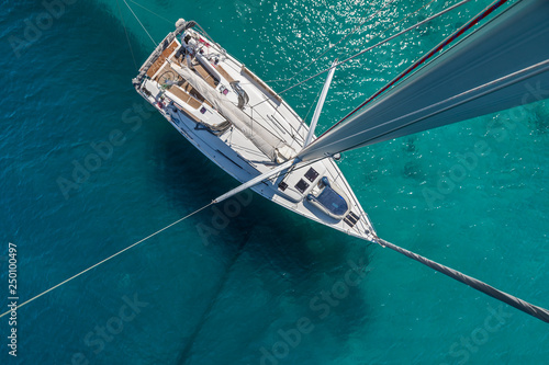 Top view of sailing boat anchored in the shallows