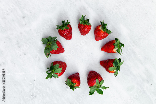 Strawberries frame patterne on on a white marble background . top view. copy space - 250108839