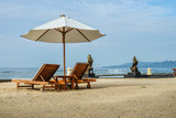 Beach lounge chairs with umbrella on the beach
