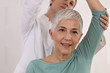 Leinwanddruck Bild - Mature Woman having chiropractic back adjustment. Osteopathy, Physiotherapy, Sport injury rehabilitation concept, holistic care