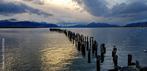 Lights of the sunset over the remains of the pier (Muelle Braun y Blanchard) in Puerto Natales, Chile © Marco