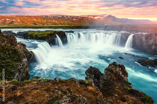 Colorful sunrise on Godafoss waterfall on Skjalfandafljot river, Iceland - 250142834