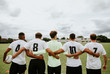 Leinwanddruck Bild - Football players standing together side by side