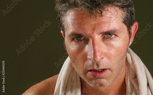 4c8ccc7de47f head and shoulders portrait of young attractive and handsome sport man  sweating after gym workout training
