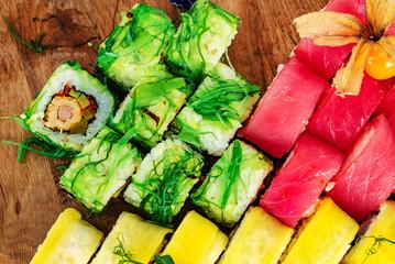Rainbow Sushi Roll with salmon, eel, tuna, avocado, royal prawn, cream cheese Philadelphia, caviar tobica, chuka. Sushi menu. Japanese food © Maksim Shebeko