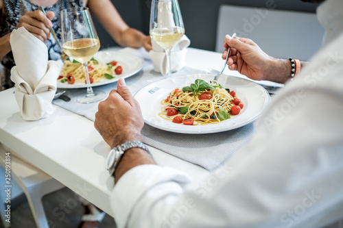 Woman and man have dinner in a restaurant - 250193814