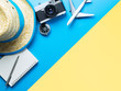 Summer Travel accessories on blue and Yellow background copy space