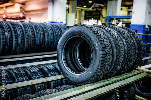 Group of new tires ready for transporting at factory - 250212625