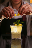 Barmen is making Fitzgerald cocktail - 250219211