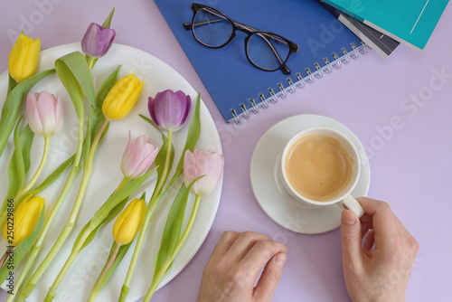 Cup of coffee and tulips on spring table - 250229866