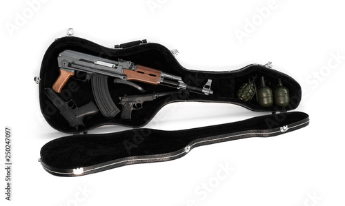 firearm weapon in a guitar case © serikbaib