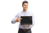 Young man holding a laptop computer and pointing to the screen - 250265663