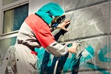 Fototapeta Młodzieżowe - Graffiti remover © Konstantinos Moraiti