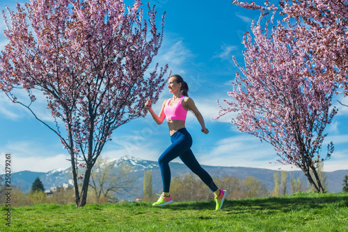 Woman running for fitness on a spring day - 250279261