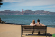 Romantic loving couple having a date in San Francisco, California, USA. Golden gate bridge in the background