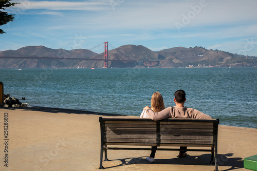 mata magnetyczna Romantic loving couple having a date in San Francisco, California, USA. Golden gate bridge in the background