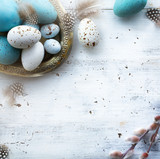 Sunny Easter background with Easter eggs on white table - 250288060