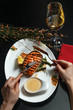 Grill fish with sauce and a glass of white wine. Restaurant feed. Top view. - 250303236