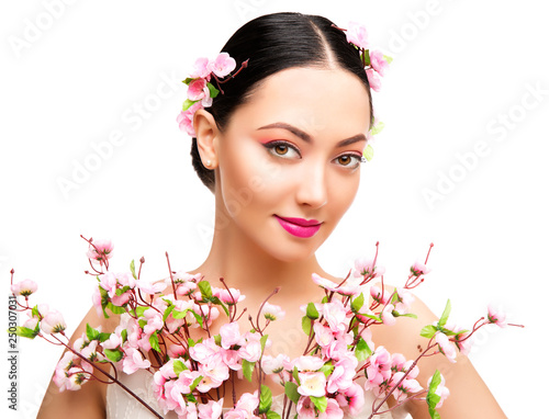 Woman Beauty Makeup in Sakura Flowers, Fashion Model Studio Portrait, Beautiful Girl Isolated over White Background © inarik