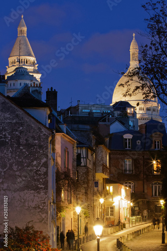 fototapeta na ścianę Paris, France - February 3, 2018: Sacre Coeur basilica in Montmartre district at night
