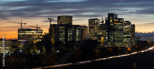 Sunset cityscape of Zuidas the business and commercial  zone of Amsterdam. - 250316822
