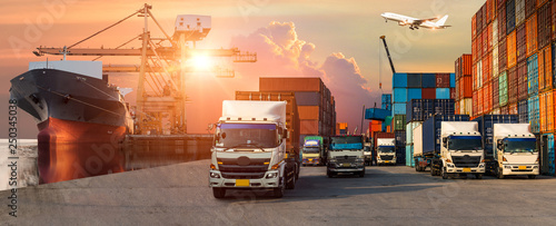 Leinwandbild Motiv Business Logistics and transportation concept of Container Cargo ship and Cargo plane with working crane bridge in shipyard at sunrise, logistic import export and transport industry background