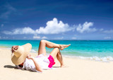woman relax on the beach. Happy island lifestyle. White sand, blue cloudy sky and crystal sea of tropical beach. Vacation at Paradise. Ocean beach relax
