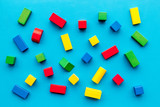 Children background. Wooden building blocks for developing and entertainment on blue background top view