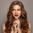 Leinwanddruck Bild - Smiling red haired woman portrait. Cute redhead girl with curly hair