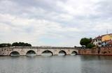 stone Tiberius bridge Rimini cityscape Italy