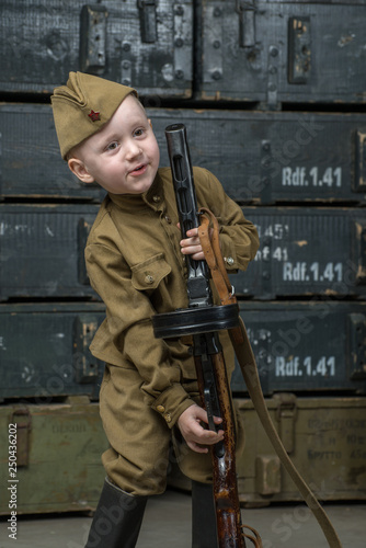 The boy is dressed in military uniform © Goncharenya Tanya