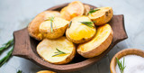 Roasted potatoes with rosemary herb in wooden bowl - 250439898