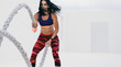 Fitness woman doing workout using battle ropes