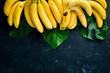 Quadro Fresh yellow bananas on a black stone table. Top view. Free copy space.