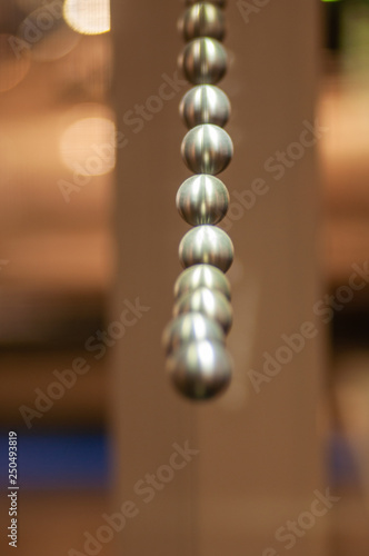 canvas print picture metal balls on string