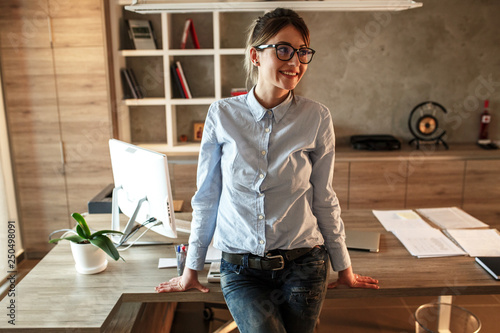 Portrait of mid age business woman.She standing in her office. © SolisImages