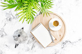 Home office workplace notebook coffee green plant