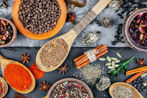 Spices and seasonings for cooking in the composition on the table © vizafoto