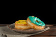 Quadro Yellow and green donuts on a designer plate.