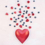 Valentine Day composition berries and red heart