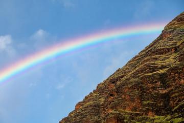 Mount Kaala in in Oahu with a beautiful rainbow © Guy