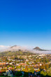 Clouds around Mountain Peaks and City - 250539437