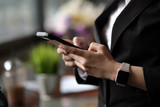 Businesswoman using mobile smartphone in office