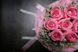 Pink rose bouquet on black cement background